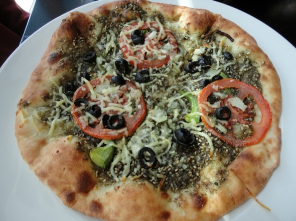 Dressed zaatar pizza at VU Halal Kitchen.